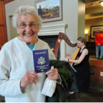 Woman holding passport at Passport to Fun event