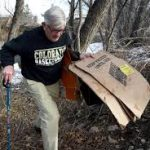 Resident John Canova Picking up Trash at Boulder Creek
