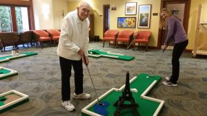 Resident playing miniature golf at Fairwinds - Redmond