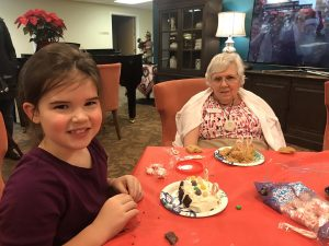 Girl Scouts Decorate Gingerbread Houses with Canfield Place Residents