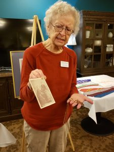 Artist displaying piece at Canfield art show