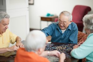 Residents doing puzzles in assisted living