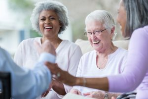 Seniors smiling in assisted living